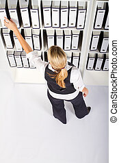 businesswoman searching file - overhead view of young...