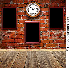 empty photo frames and watch against an brick wall in old...
