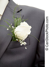 rose in his lapel of his jacket the groom - white rose in...
