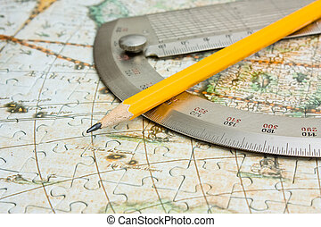 pencil and protractor on map - pencil and protractor on the...