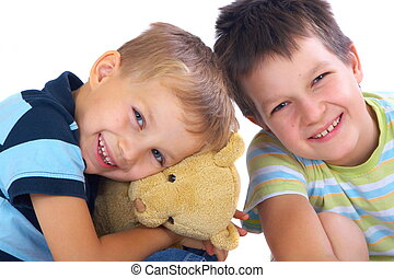 Happy brothers and teddy bear - Two happy brothers with toy...