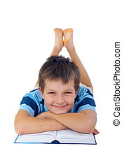 Smiling Boy With Book - Smiling boy on his stomach with his...