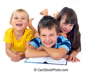 Three kids reading on floor - An isolated shot of three...