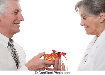 An elderly man gives a lady a gift on a white background -...