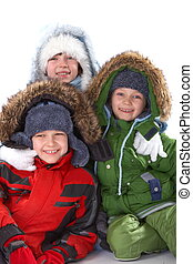 Children in winter clothing - Three smiling children wearing...