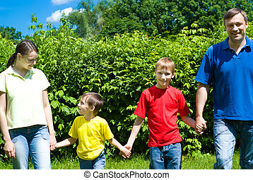 happy family of four - portrait of a happy family of four