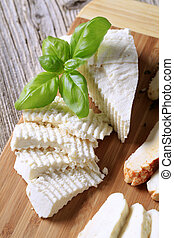 Feta cheese - Slices of feta cheese on a cutting board