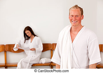 Man at Spa - Portrait of a man at a spa with a woman in the...