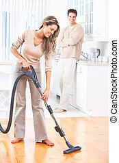 Housework - House work vacuum cleaner young couple home...