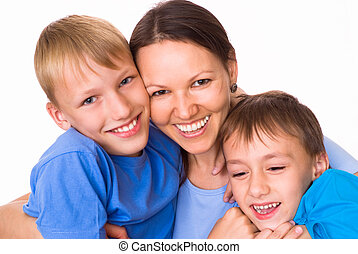 mom with her two children on a light background