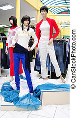Plastic mannequins in clothes store