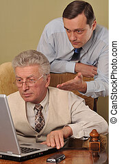 Two businessman working  at the computer