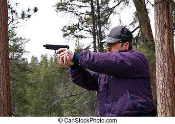 45 caliber pistol - The slide is half way open in this...