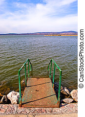 Early spring at lake - Stairs leading into lake Velence,...