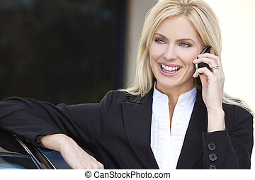 Blond Businesswoman Talking On Her Cell Phone - A beautiful...