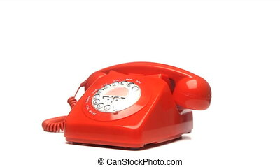 Red phone rotating - Red fixed phone rotating on a white...