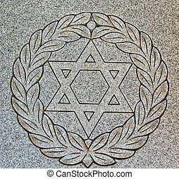 Star of David on old grunge granite tombstone. Old Jewish...