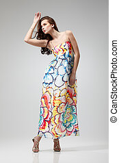 Spring - Young beautiful female model in colorful dress on...