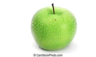 Wet green apple rotating on a white background