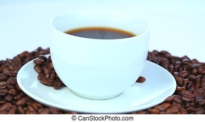 Cup of coffee with coffee beans rot - Cup of black coffee...