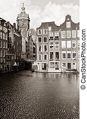 Sint Nikolaas Kerk - Canal with houses and St Nicholas...