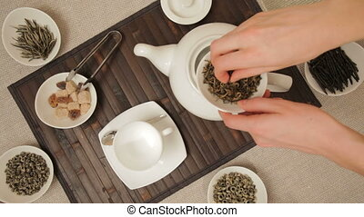 TL Woman preparing green tea