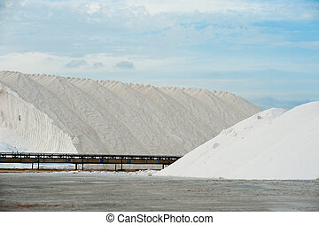 Salt mines - Industrial salterns, raw material piled up next...