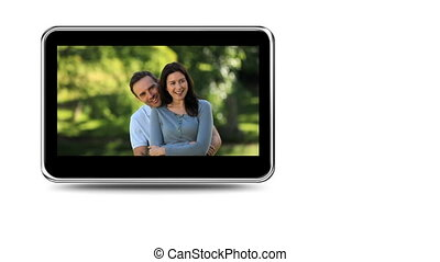 Montage of couples outdoors - Montage on mobile screen of...