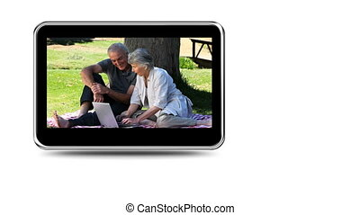 Montage of a retired couple relaxin - Montage on mobile...