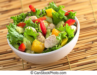 Fresh chicken salad seasoned with pepper with lettuce,...