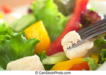 Fresh chicken salad with lettuce, red bell pepper, mango and...
