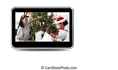 Montage of families celebratingxmas - Montage on mobile...