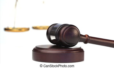 Gavel in action on a white background