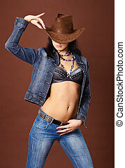 Beautiful sexy girl in jeans and cowboy hat - Young...