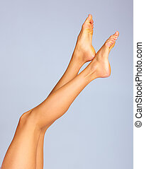 Legs - Beautiful woman legs. Over grey background. Body...