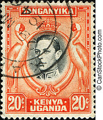 KENYA, UGANDA AND TANGANYIKA - CIRCA 1951: A stamp printed in East Africa shows  medallion portrait of King George V, surrounded of storks, circa 1951