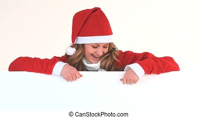 Young blonde woman dressed up as Santa Claus in a studio