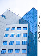 Modern office building. The windows reflect the sky. Ventral...