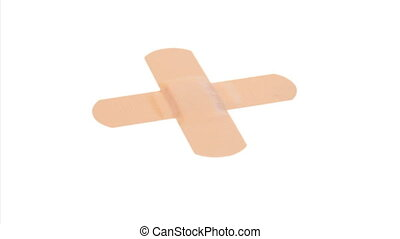 Plasters arranged crosswise rotatin - Plasters arranged...