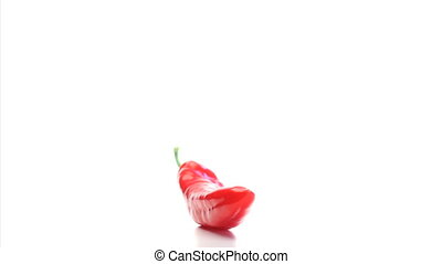 Red pepper rotating on a white background