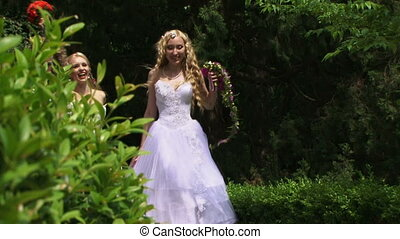 Group of brides - Beautiful girls in wedding dresses run...