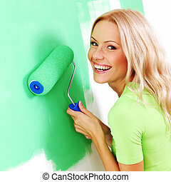 woman paint on wall - woman paints the wall brush