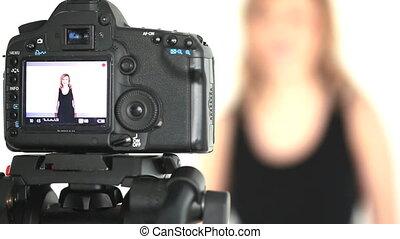 Camera taking shot of blonde woman