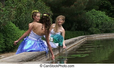 Brides on a pond