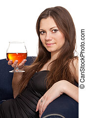 Woman is holding a glass of wine