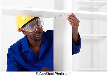 african american carpenter assembly furniture