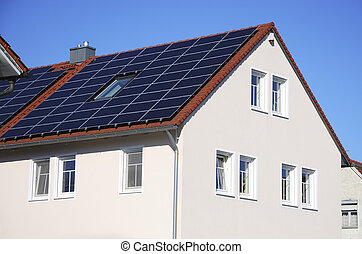 Green energy - Photovoltaic cells on the roof of a house