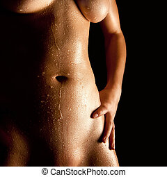 Wet body of a nude young woman
