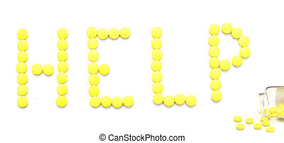 yellow pills spelling the word help over white background
