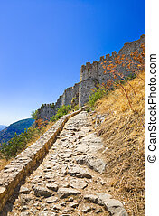 Stairs to old fort in Mystras, Greece - travel background